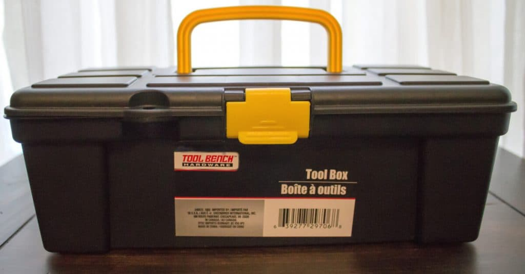 closed first aid toolbox sitting on table