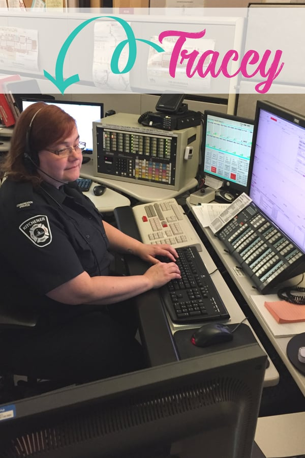 911 dispatcher sitting at desk