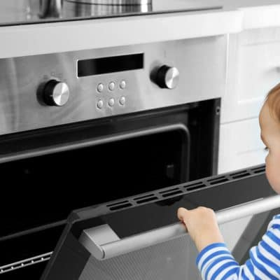 Child opening oven