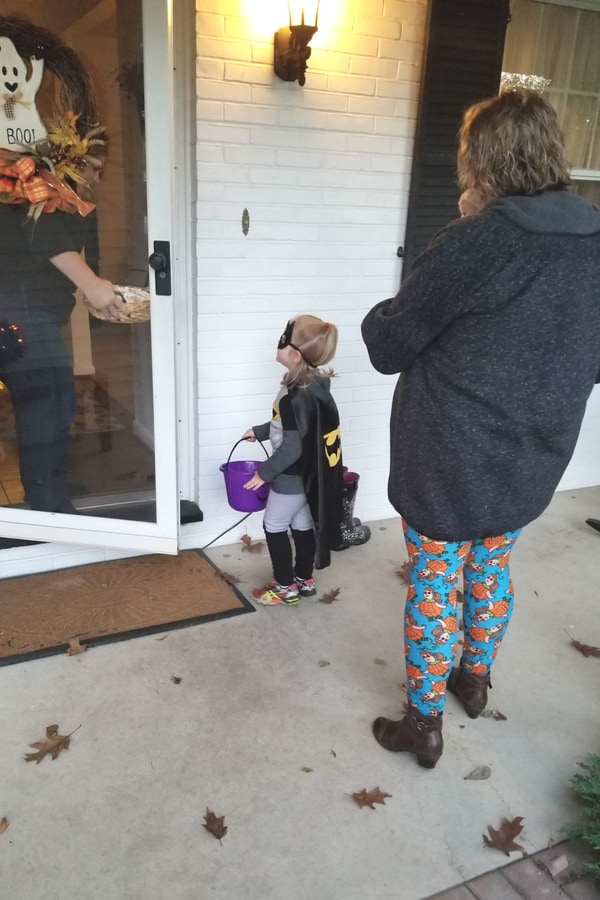 image of family trick or treating
