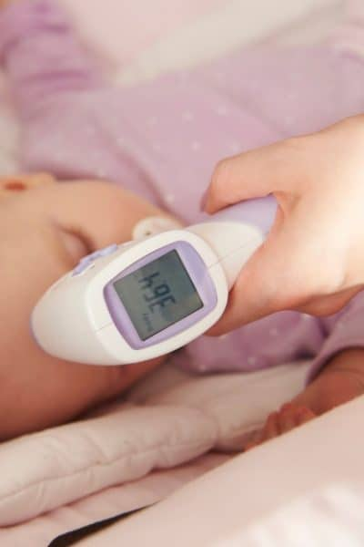 image of baby getting temperature taken