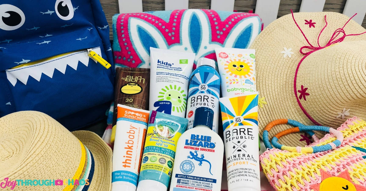 image of sunscreens laying on beach towel