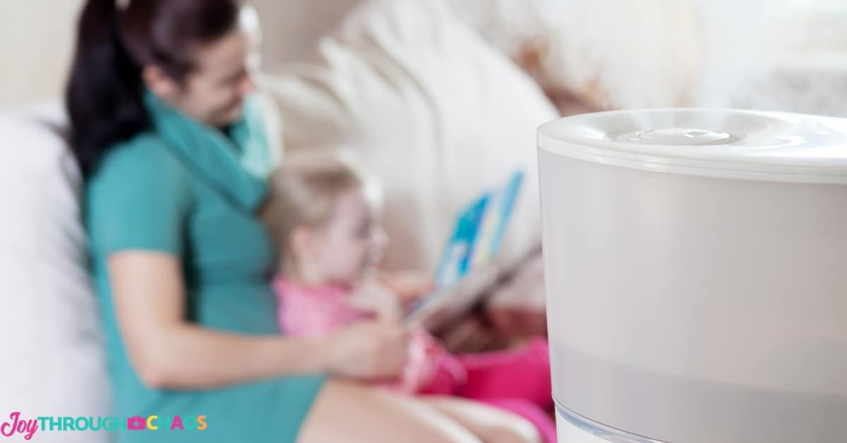 mother reading to child with humidifier in foreground