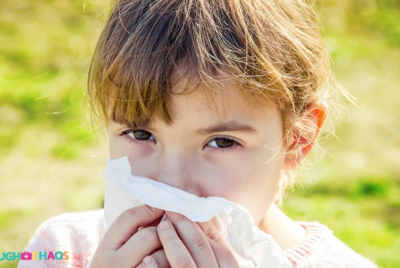child with runny nose looking at camera