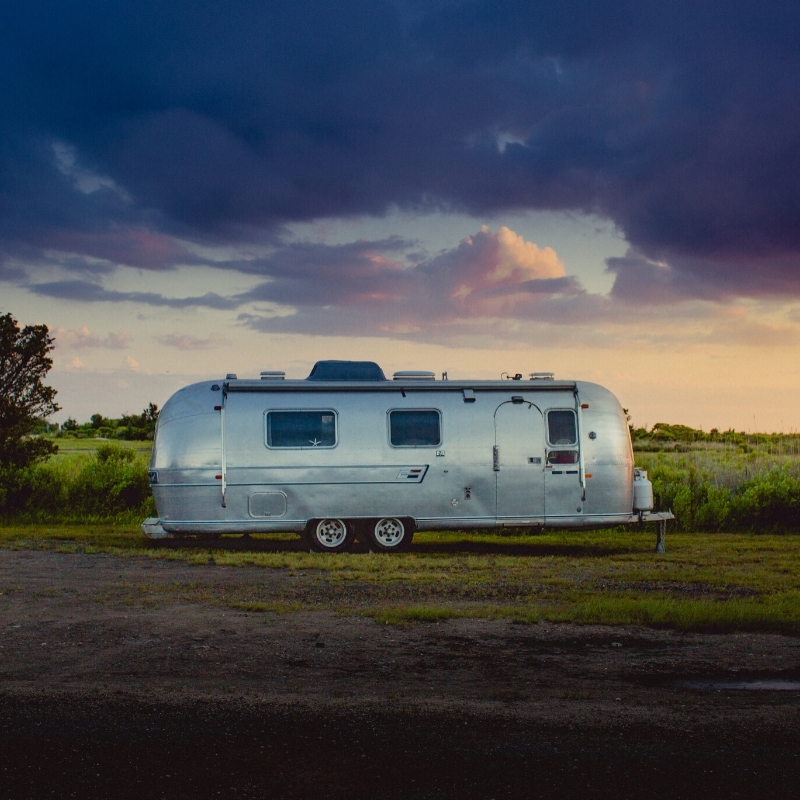 Parked Travel Trailer with sunset in background