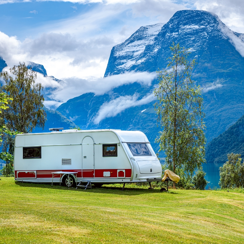 Travel trailer parked overlooking a lake